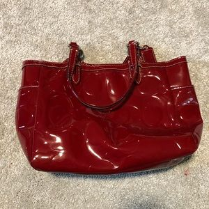 Coach red patent leather purse.